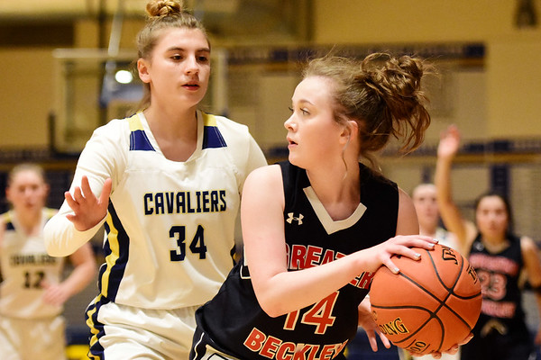 Greater Beckley Christian's Emma Moss (14) looks to pass while being guarded by Greenbrier West's (34) (23) during their basketball game in Charmco on Thursday. (Chris Jackson/The Register-Herald)