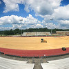 Crews preparing the Woodrow Wilson High School football field to lay astro turf to be ready for the start of football season in September.<br /> (Rick Barbero/The Register-Herald)