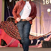 """(Brad Davis/The Register-Herald) Lee Reedy struts for the audience during the Hunks in Heels """"Fur"""" Real fundraising event Friday night at the Beckley Moose Lodge."""