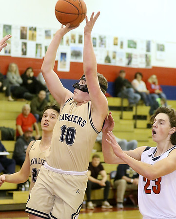 (Brad Davis/The Register-Herald) Greenbrier West's Chase McClung pulls up for a jump shot as Independence's Michael McKinney defends Thursday night in Coal City.
