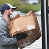 Jerad Cook, volunteer, loading up a bus with meals at Westside High School in Wyoming County for students because of the coronavirus crisis.<br /> (Rick Barbero/The Register-Herald)