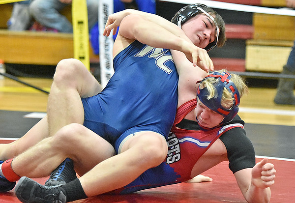 (Brad Davis/The Register-Herald) Nicholas County's Conner Jones takes on Midland Trail's Dylan Buckland in a 170-pound weight class matchup during the Coalfield Conference Invitational Friday night in Oak Hill. Midland Trail's Buckland pinned Jones to win the match.