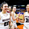 (Brad Davis/The Register-Herald) Woodrow Wilson players celebrate modestly at mid court knowing the job isn't yet done after the Lady Flying Eagles defeated Morgantown to advance in the Girls State Basketball Tournament Wednesday afternoon in Charleston.