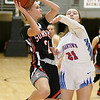 (Brad Davis/The Register-Herald) Summers County's Gavin Pivont drives and scores as Morgantown's Berit Johnson defends during the final day of Big Atlantic Classic action Saturday at the Beckley-Raleigh County Convention Center.