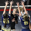 Sullivan Pivont, of Summers Co., center, spikes the ball over, Meagan Poticher, left, and Linzy Sawyers, of Greenbrier West, during the quarter-final match of the Girls State Volleyball Tournament held at the Charleston Civic Center Wednesday morning. Summer Co. won 3 sets to 1<br /> (Rick Barbero/The Register-Herald)
