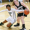 (Brad Davis/The Register-Herald) Wyoming East's Daisha Summers reaches for a loose ball with Westside's Lauren Thomas during Friday action at the New River Community and Technical College Shootout at the Beckley-Raleigh County Convention Center.