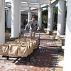 Gordon Coleman carts out bags of meals prepared by Tamarack in Beckley Monday morning to load up on W.Va. National Guard truck Monday morning. Tamarack joined together with Raleigh County and Monroe schools to provide two meals a day for five day to 1500 students from each county. 1500 meals were delivered to Monroe County Monday morning and additional 1500 meals will be prepared and delivered in Raleigh by the W.Va. National Guard to help continue feeding students during the coroanvirus crisis.<br /> (Rick Barbero/The Register-Herald)