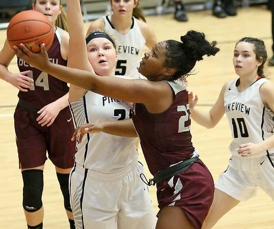 (Brad Davis/The Register-Herald) Woodrow Wilson's Victoria Staunton drives and scores as PikeView's Shiloh Bailey defends during the New River Community and Technical College Shootout Saturday at the Beckley-Raleigh County Convention Center.