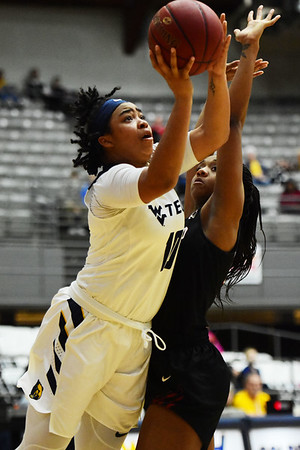 WVU Tech's Alexandria Gray (10) goes up for a layup over a IU Kokomo defender during their River State Confernece quarterfinal game in Beckley on Wednesday. (Chris Jackson/The Register-Herald)