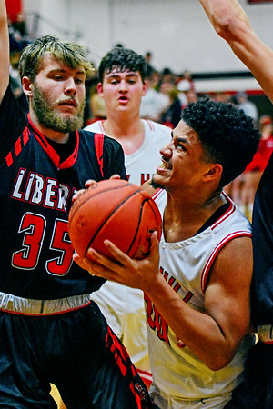 Oak HIll's Darian McDowell goes up for a layup as Liberty's Hunter Lambert (35) defends during the first half of their basketball game in Oak Hill on Tuesday. (Chris Jackson/The Register-Herald)