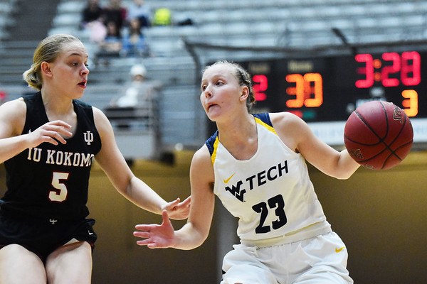 WVU Tech's Brittney Justice dribbles past IU Kokomo's (5) during their River State Confernece quarterfinal game in Beckley on Wednesday. (Chris Jackson/The Register-Herald)