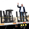 Pastor John Jordan of the Calvary Assembly of God Church, preaches on top of a flatbed trailer in the churches parking lot during their church service Sunday morning to celebrate the Easter holiday with the congregations listening on the radio inside their vehicles due to the  COVID-19 pandemic. <br /> (Rick Barbero/The Register-Herald)