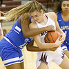 (Brad Davis/The Register-Herald) Woodrow Wilson's Cloey Frantz wins the battle for a loose ball with Capital's Kierra Brown Wednesday night in Beckley.