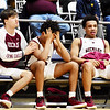 Woodrow Wilson's Michael Cadle, from left, consoles Bryant Jones as Richard Law looks on emotional during their Class AAA, Region 3 Conference Final Game against St. Albans in Beckley on Tuesday. (Chris Jackson/The Register-Herald)