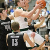 (Brad Davis/The Register-Herald) Wyoming East's Chase York drives to the basket as Westside's Tommy Milam (#44) defends during the New River Community and Technical College Shootout Saturday at the Beckley-Raleigh County Convention Center.