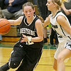 (Brad Davis/The Register-Herald) Westside's Makayla Morgan drives as Wyoming East's Skylar Davidson defends Wednesday night in New Richmond.
