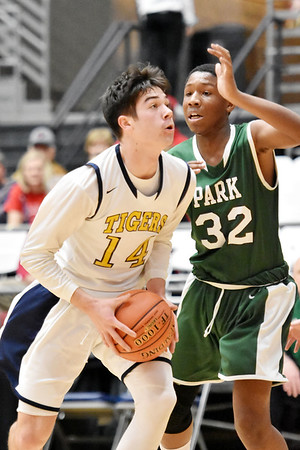 Shady Spring's Brady Green goes up for a shot as Park's Nazir King defends during the first half of their middle school Big Atlantic Classic basketball game in Beckley on Monday. (Chris Jackson/The Register-Herald)