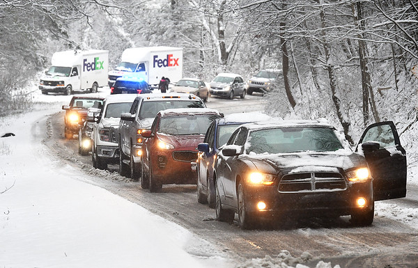 FedEx truck got stuck on Airport Road in Beaver causing traffic to get backed up Tuesday morning.<br /> (Rick Baerbero/The Register-Herald)