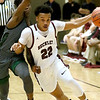 (Brad Davis/The Register-Herald) Woodrow Wilson's Richard Law drives up the court as Hampshire's Mikhi Anderson defends during Big Atlantic Classic action Friday at the Beckley-Raleigh County Convention Center.