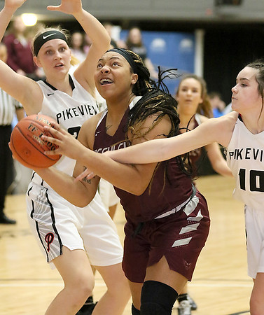 (Brad Davis/The Register-Herald) Woodrow Wilson's Jamara Walton drives to the basket as PikeView's Laken KcKinney, left, and Hope Craft defend during the New River Community and Technical College Shootout Saturday at the Beckley-Raleigh County Convention Center.