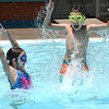 Lila Hiener, 7, left, and her brother Liam Heiner enjoying the warm weather playing in the pool at The Resort at Glade Springs in Daniels Wednesday afternoon.<br /> (Rick Barbero/The Register-Herald)