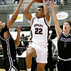 (Brad Davis/The Register-Herald) Woodrow Wilson's Richard Law drives to the basket as Riverside's Jeremiah Mason, left, and Josh Arthur defend Wednesday night at the Beckley-Raleigh County Convention Center.