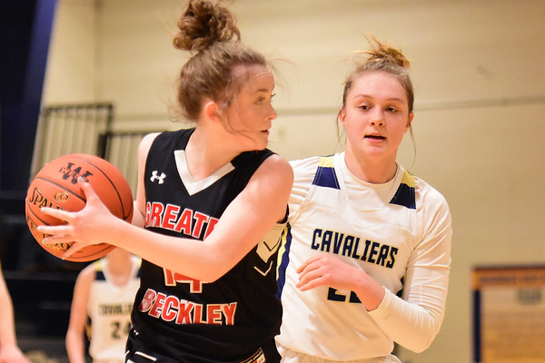 Greenbrier West's (20)  guards Greater Beckley Christian's Emma Moss (14) during their basketball game in Charmco on Thursday. (Chris Jackson/The Register-Herald)