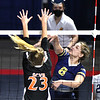 Gavin Pivont, of Summers Co., left, tries to block a spike against, Linzy Sawyers, of Greenbrier West, during the quarter-final match of the Girls State Volleyball Tournament at the Charleston Civic Center Wednesday morning.<br /> (Rick Barbero/The Register-Herald)