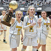 (Brad Davis/The Register-Herald) Greenbrier East players (from left) Kate Perkins, Haley McClure and A.J. groves celebrate with the hardware after defeating University to win the Class AAA girls championship during the final night of Big Atlantic Classic action Saturday at the Beckley-Raleigh County Convention Center.