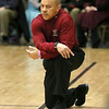 (Brad Davis/The Register-Herald) Woodrow Wilson head coach Ron Kidd monitors his team as they take on Cabell Midland Thursday night at the Beckley-Raleigh County Convention Center.