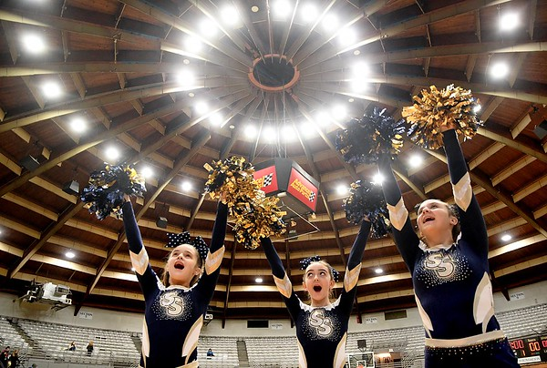 Shady Spring Middle School cheerleaders, Audreona Kesler, left, Karlin Nyers and Kiersten Price, during the Big Atlantic Classic game against Pikeview Middle School, held at the Beckley Raleigh County Convention Center Monday afternoon. The 31st annual Big Atlantic Classic kicked off Monday with eight games involving, Elementary, Middle and High School teams. Variety of games will continue everyday this week and will end Saturday, February 1 with consolation championship games. Staurday's session will begin at 9 am.<br /> (Rick Barbero/The Register-Herald)