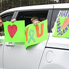 Courtney Ansley, of Stanaford left, and her son Mason, 10, displays a message as they make a brief stop in a parade of cars past, Tammy Evans, of Beckley, home on the corner of, Park Ave. and Third Ave., Family and friends celebrated with a parade of 14 cars and two fire trucks the one year anniversary of her daughter, Shannon Barbero, of Prosperity, donating half her liver to save her mothers life. Evans, who suffered from NASH, nonalcoholic steatohepatitis, stood her distance because of COVID-19, was surprised and said, How many people can say they had their own parade?<br /> (Rick Barbero/The Register-Herald)