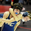 Nicholas County's Roger Thomas wrestles Richlands Rose during their 106-weight class<br /> during the West Virginia Army National Guard Duals in Summersville on Friday. (Chris Jackson/The Register-Herald)