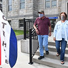 Randy and Janet Crawford, of Cool Ridge, exits the Raleigh County Courthouse on Prince Street in Beckley after early voting.<br /> (Rick Barbero/The Register-Herald)