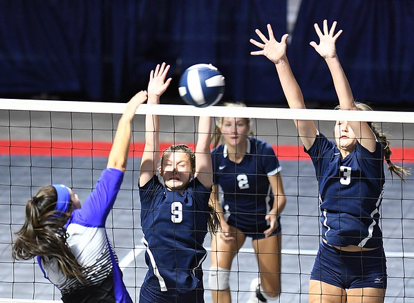 Aly Holdren, second from left, Kelsie Dangerfield and Meg Williams, of Shady Spring, guard the net againt Robert C Byrd in the semi-final match of the Girl Calss AA State Volleyball Tournament held at the Charleston Civic Center Friday afternoon.<br /> (Rick Barbero/The Register-Herald)