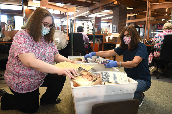 Amy Stover, director of Raleigh County Library, left and Crystal Andrighetti, bookmobile librarian, sort through books that were dropped off at their local branches. The library was closed down for six week because of COVID-19 and just reopen on Tuesday, May 26. Starting June 1 to July 31 they will offer a summer reading program for children 3 to 12 and 13 and up. This is an 8 week program and children will be provided a new activity bag each week. Library will be opened Monday-Friday 9:30 to 5:30 and Saturday 10 am to 2 p.m. and will also provide curb sevice if requested.