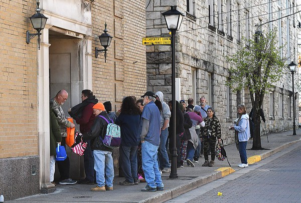 Large group of people wait outside the entrance of Carpenters Corner on Prince Street in Beckley Thursday afternoon.