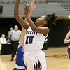 (Brad Davis/The Register-Herald) Woodrow Wilson's Latoya Creasy drives to the basket as Morgantown's Kate Hawkins defends during Big Atlantic Classic action Thursday night at the Beckley-Raleigh County Convention Center.