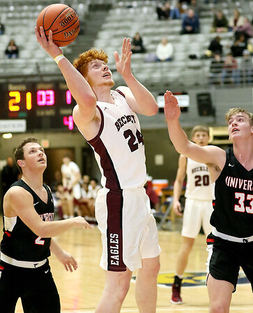 (Brad Davis/The Register-Herald) Woodrow Wilson's Ben Gilliam drives to the basket as University's Kyle Smith, left, and Aaron Forbes defend during the final night of Big Atlantic Classic action Saturday at the Beckley-Raleigh County Convention Center.