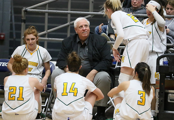 (Brad Davis/The Register-Herald) Greenbrier East head coach Jim Justice talks with his team during a timeout Thurday night.