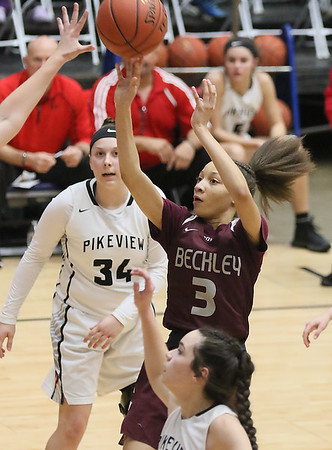 (Brad Davis/The Register-Herald) Woodrow Wilson's Keanti Thompson puts up a short-range jump shot as PikeView's MaKenzee Shrewsbury defends during the New River Community and Technical College Shootout Saturday at the Beckley-Raleigh County Convention Center.