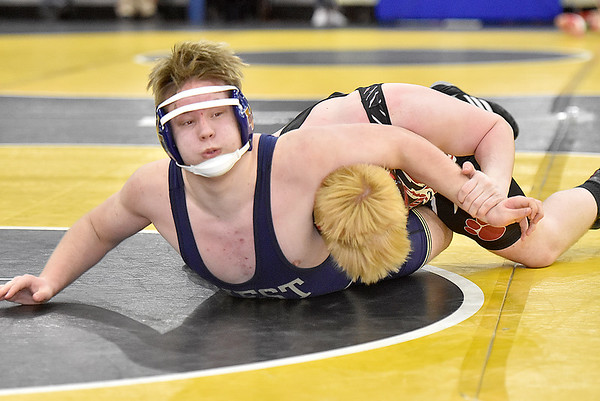 (Brad Davis/The Register-Herald) Greenbrier West's Joey Terry takes on Nitro's Scott Worstell in a 195-pound weight class matchup Friday afternoon at the 73rd Annual State Wrestling Tournament in Huntington. Nitro's Worstell won the match.
