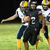 Ryan Simms, of Liberty, breaks away from Clay County defenders during game at Liberty High School Friday, September 25.<br /> (Rick Barbero/The Register-Herald)