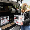Treana Dacal, board chairman United Way of Southern West Virginia, loads up boxes of nonperishable food items that was picked up at the Salvation Army on South Fayette Street in Beckley for volunteers of the United Way to deliver to seniors and other families. 102  boxes of food was provided to the Salvation Army by Mountaineer Food Bank with 52 going to the United Way and 50 to Bethel Church in Nicholas County for distribution.<br /> (Rick Barbero/The Register-Herald)