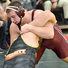 (Brad Davis/The Register-Herald) Woodrow Wilson's Ian Pomeroy takes on University's Corbin Turney in a 285-pound weight class matchup Friday afternoon at the 73rd Annual State Wrestling Tournament in Huntington. Pomeroy won the match.