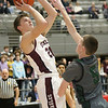(Brad Davis/The Register-Herald) Woodrow Wilson's Ayden Ince pulls up for a short-range shot as Hampshire's Seth Eaton defends during Big Atlantic Classic action Friday at the Beckley-Raleigh County Convention Center.