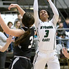 (Brad Davis/The Register-Herald) Wyoming East's Daisha Summers drives to the basket as Westside's Hannah Toler defends during Friday action at the New River Community and Technical College Shootout at the Beckley-Raleigh County Convention Center.