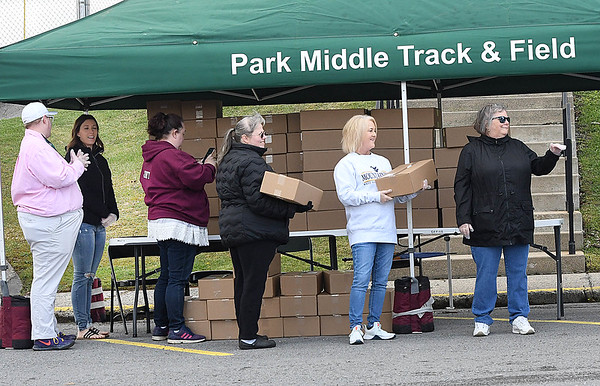 Raleigh County School employees distributed free meals at Park Midddle School because of the coronavisus crisis Thursday morning. Nearly 2,000 meals were provided by U.S. Foods, and another 2,000 meals were provided by the Historic Black Knight Municipal Park, giving each school site 150 meals to distribute. <br /> (Rick Barbero/The Register-Herald)
