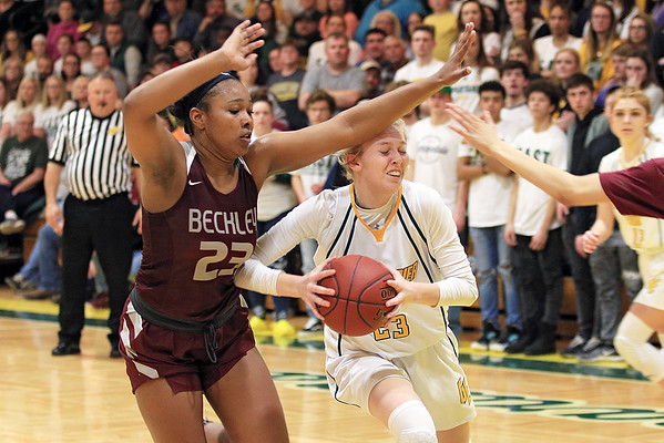 Greenbrier East's Haley McClure tries to get around Woodrow Wilson's Victoria Staunton during the Class AAA Region 3 Section 2 championship game at Greenbrier East Friday. (Jenny Harnish/The Register-Herald)
