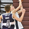 (Brad Davis/The Register-Herald) WV Wilcats' Max Wilcox drives and scores as Southern West Virginia Hustle's Bryson Blankenship defends during the Roundball Classic 7th Grade Championship Sunday morning at Woodrow Wilson High School. WV Wildcats won the game and took the title.